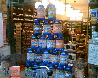 Whey protein - Containers of whey protein being sold at a health food store.