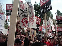 Writers raise signs at wga rally.jpg