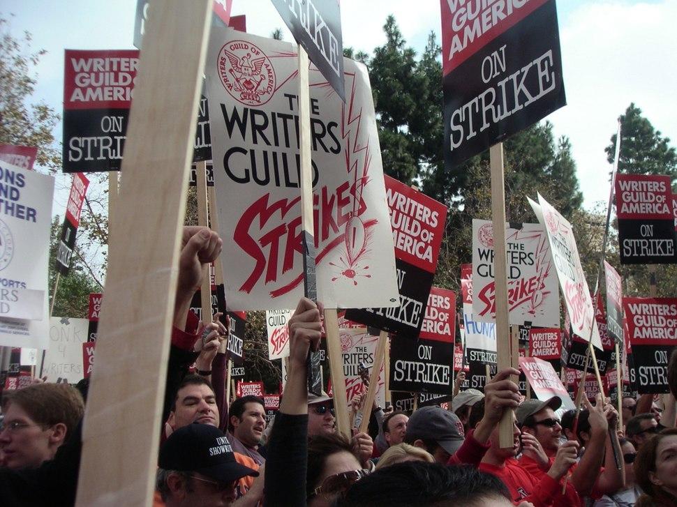 Writers raise signs at wga rally