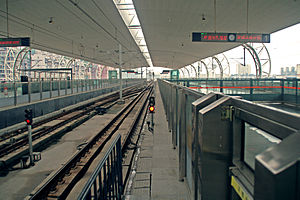 Cross-platform interchange - Cross-platform interchanges between different train categories in Xipu Railway Station, Chengdu. The double track of the urban railway (Line 2 of Chengdu Metro) is in the middle, while the double tracks of national rail transport system (Chengdu–Dujiangyan Intercity Railway) are on both sides.