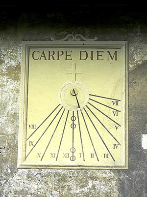 Sundial on the side of a building in Yvoire, H...