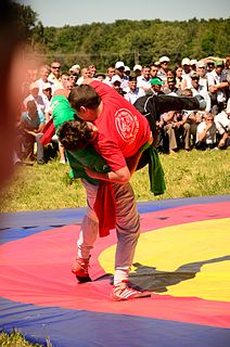 Kurash folk wrestling styles practiced in Central Asia