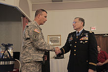 U.S. Army Col. Edward Rothstein, left, shakes hands with Medal of Honor recipient Lt. Col. Alfred Rascon at the Fort Meade Community Soldier/Family Resiliency Fair in Maryland Sept. 20, 2011.