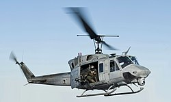 120131-N-XK513-120 Sailor directs a UH-1N Huey helicopter from (VMM) 261 (cropped).jpg