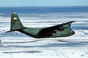 185th Air Refueling Squadron - A U.S. Air Force Lockheed C-130H-LM Hercules aircraft (s/n 78-0812) from 185th Airlift Squadron, 137th Airlift Wing, Oklahoma Air National Guard (ANG), flies over snow blanketed New Mexico en route to deliver hay to cattle stranded in remote fields after a major blizzard hit the area in December 1997.