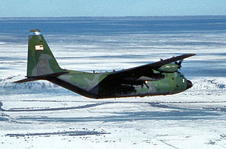 185th Special Operations Squadron - A U.S. Air Force Lockheed C-130H-LM Hercules aircraft (s/n 78-0812) from 185th Airlift Squadron, 137th Airlift Wing, Oklahoma Air National Guard (ANG), flies over snow blanketed New Mexico en route to deliver hay to cattle stranded in remote fields after a major blizzard hit the area in December 1997.