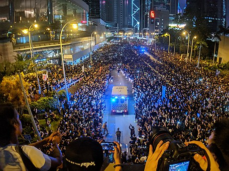 Protesters making way for an ambulance on Queensway at night. 190616 HK Protest Incendo 17.jpg