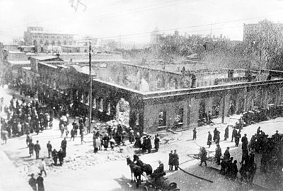 Remains of the editorial offices of the Kaspi newspaper on Baku's Nikolayevskaya Street (modern-day Istiqlaliyyet Street), ruined during the March Days in 1918. 1 march days 1918.jpg