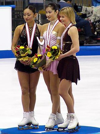 Miki Ando - Ando (far left) at the 2004 NHK Trophy ceremony