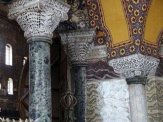 "Basket capitals and verd antique and marble columns. The basket capitals of the building are carved with monograms of the names Justinian (Greek: 'Ioustinianos, romanized: Ioustinianos ) and Thedora (Theodora, Theodora ) and their imperial titles ""basileus, basileus "" and ""augousta, augousta "". 20131203 Istanbul 130.jpg"