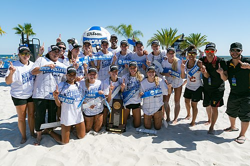 The USC Trojans women's beach volleyball team poses with the National Championship trophy after winning the inaugural 2016 NCAA Beach Volleyball Championship. 2016 National Champs USC.jpg