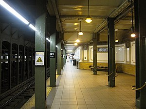 33rd Street (IRT Lexington Avenue Line) - Downtown platform with Arts for Transit artwork on the columns