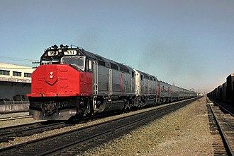 EMD SDP40F - No. 551 at Newhall Yard in San Jose, California, with the Coast Starlight in 1975. The later SDP40Fs were distinguished from the first 40 by lower-profile cooling fans.