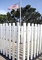 A U.S. flag is shown at the USS Oklahoma Memorial at Joint Base Pearl Harbor-Hickam, Hawaii 121207-N-KT462-051.jpg
