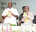 A book of 'Cooperative Surge Ahead' released and first copy being presented to the President, Shri Pranab Mukherjee, at the inauguration of the 16th Indian Cooperative Congress.jpg
