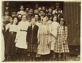 A group of girl workers at Greenabaum's Cannery, Seaford, Del. The girls in the front row are 'cappers' and 'layers.' They range from 6 years of age up. Working from 10 to 12 hours per day. LOC nclc.00800.jpg