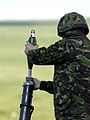 A member of 51 Squadron RAF Regiment, loading a 81mm Mortar before a live firing. MOD 45144832.jpg