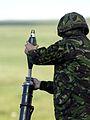 A member of 51 Squadron RAF Regiment, loading a 81mm Mortar before a live firing. MOD 45144832.jpg