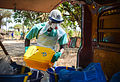 A member of the Port Loko District Ebola Response Centre peparing chlorinated water ready for the decontamination of a property MOD 45158993.jpg