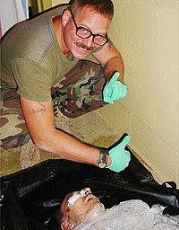Spc. Charles Graner poses over Manadel al-Jamadi's corpse.