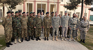 Foreign relations of Afghanistan - Bismullah Mohammadi, Ashfaq Parvez Kayani, and Stanley A. McChrystal, gather for a group photo with senior military and diplomatic representatives from Afghanistan, Pakistan and the United States prior to the 29th Tripartite Commission held at NATO International Security Assistance Forces Headquarters, Kabul, Afghanistan.