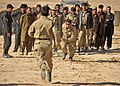 Afghan Local Police candidates conduct sprint races during a physical training class in the Nawbahar district, Zabul province, Afghanistan, March 10, 2012 120310-N-UD522-074.jpg