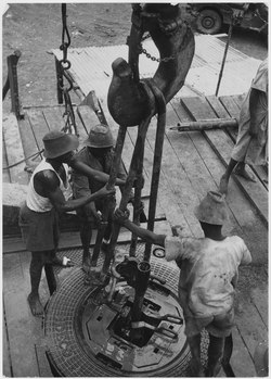Africa. Gabon, French Equatorial Africa. Native workers assemble drill pipes, the rotary table comes from Beaumont... - NARA - 541653.tif