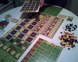 Agricola (board game) - A game of Agricola being set up.