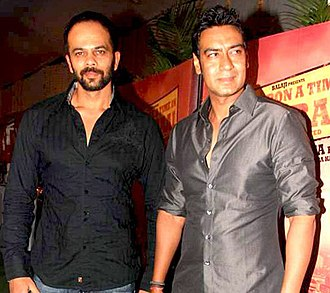 Rohit Shetty - Shetty(left) with Ajay Devgn. Shetty has directed Devgn in ten films since 2003.