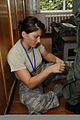 Alabama Air National Guard Tech. Sgt. Kamee Wilson, a life support technician, alters a flight suit July 21, 2011, at Mirgorod Air Base, Ukraine, for a Ukrainian pilot who is participating in Safe Skies 2011 110721-F-DQ783-012.jpg
