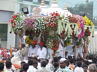 Dnyaneshwar - Dnyaneshwar's palkhi (palanquin), carrying the sandals of the saint, in silver cart pulled by Oxen on a journey from Alandi to Pandharpur.