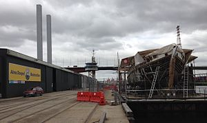 Alma Doepel on custom made barge undergoing hull work as part of complete restoration. Docklands, Victoria, Australia.