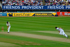 Bowling action - James Anderson in his follow through while bowling to Michael Clarke.