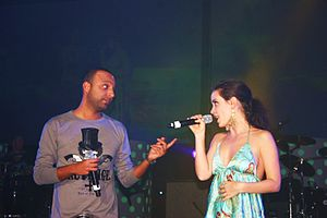 Arash (singer) - Rebecca Zadig and Arash in a concert in Las Vegas, December 2008