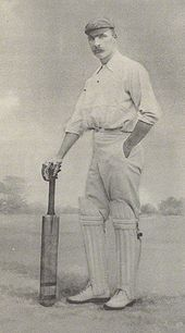 A cricketer holding a bat