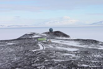 Arrival Heights - Arrival Heights ASPA 122, looking south from the foot of Second Crater. Mount Discovery in the background. In the foreground, the Antarctica New Zealand and USAP atmospheric research laboratories. The geodesic dome on the ridge houses Antarctica New Zealand's satellite communication system.
