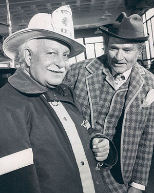 Arthur Fiedler - Fiedler dressed for the part of a fireman for a show skit. Red Skelton is dressed as Clem Kadiddlehopper.