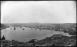 Photograph of an artist sketching St. John's harbour and skyline, c. 1910 Artist sketching the St. John's Harbour and skyline (c. 1910).jpg