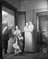 August Krafft - En gammel tigger ved døren får almisse af husets børn - KMS391 - Statens Museum for Kunst.jpg