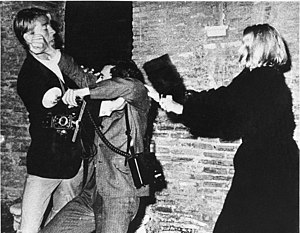 "Paparazzi - Mickey Hargitay assaults the ""king of paparazzi"" Rino Barillari while a woman hits him with her purse—Via Veneto 1963"