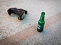 Beer glass bottle next to a lost boot (51147366937).jpg