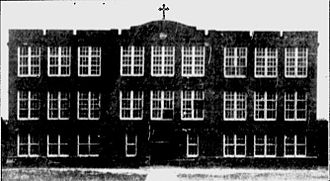 Bishop England High School - Bishop England's fourth building had 14 classrooms and was designed so that wings could be added later.