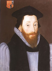 Oil painting of the head and shoulders of a man with a brown beard in clerical dress