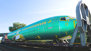 Flatcar - Boeing 737NG fuselage being transported by rail.