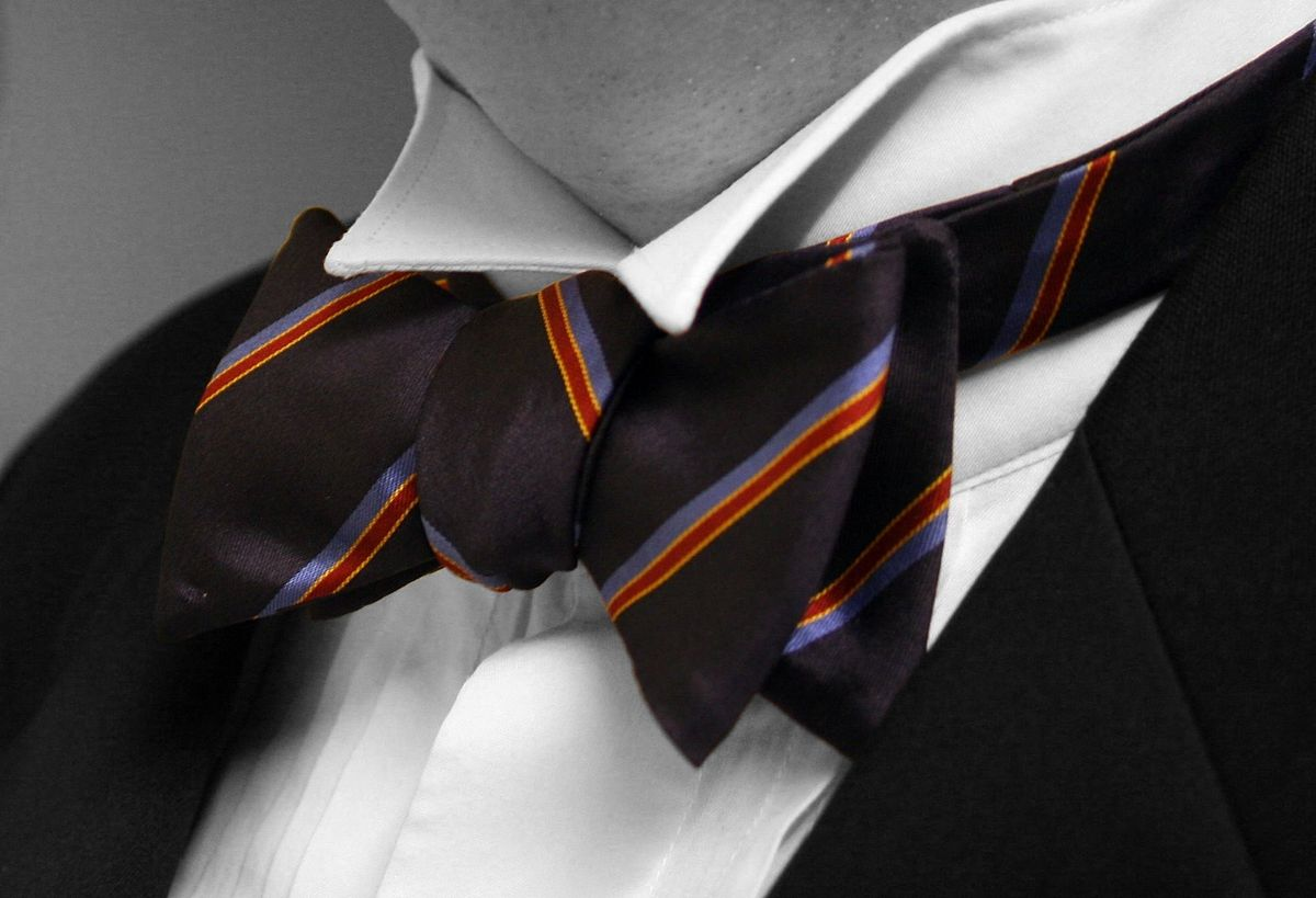 The bow tie is a descendant of the knotted cravat. It was born from the need for neckwear that was easier to wear than the cravat and that would last throughout a more active day.