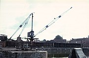 Old photograph of a crane on the quayside.
