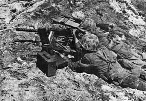 M1919 Browning machine gun - Two Marines with a M1919A4 on Namur Island during World War II