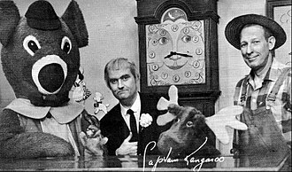 Captain Kangaroo - From left: Dancing Bear, Bunny Rabbit, Captain Kangaroo, Grandfather Clock, Mister Moose, and Mister Green Jeans.