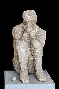 Cast sitting victim Pompeii.jpg