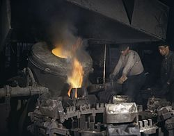 Casting a billet from an electric furnace, Chase Brass and Copper Co., Euclid, Ohio.